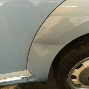 Car-With-Dented-Wheel-Arch