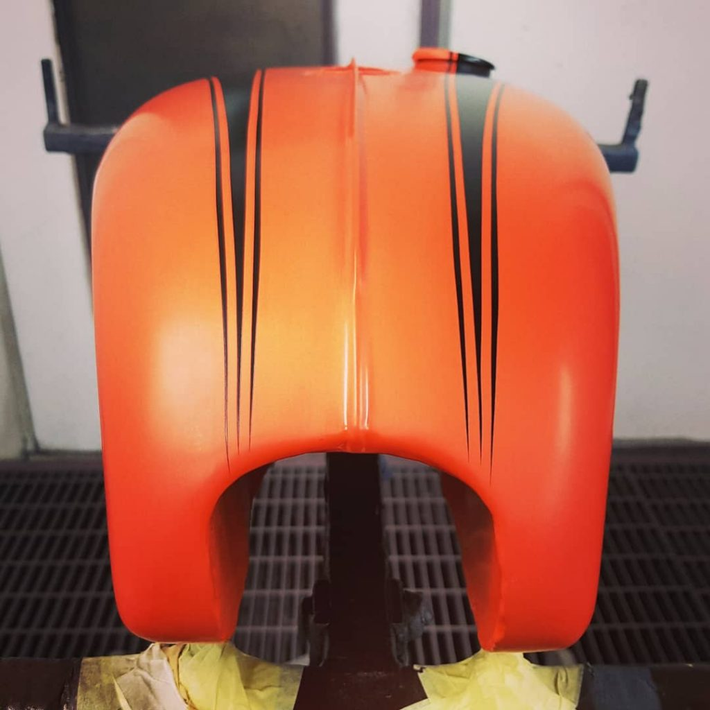 Orange Triumph motorbike custom paint job 4